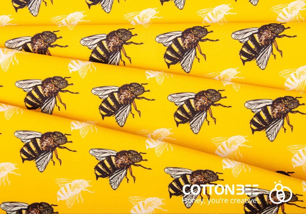 Bees on yellow fabric