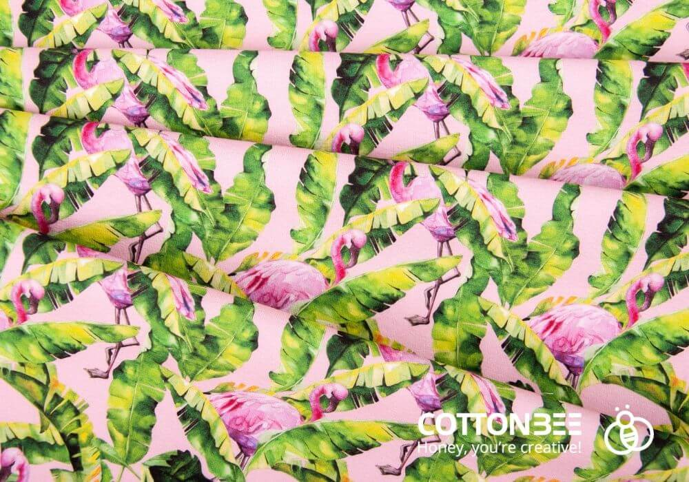 fabric with tropical leaves and pink flamingos