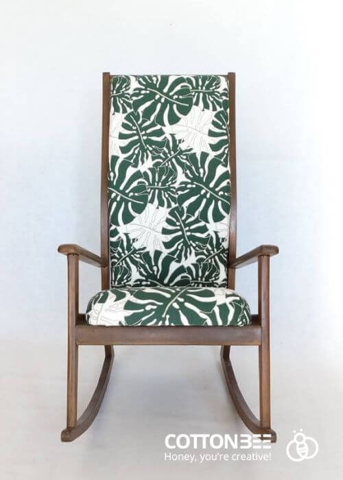 A chair with gabardine cover with monstera leaf - fabric printing