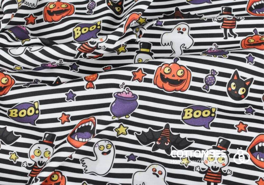 striped sewing fabric with ghosts, pumpkins, cats and sweets