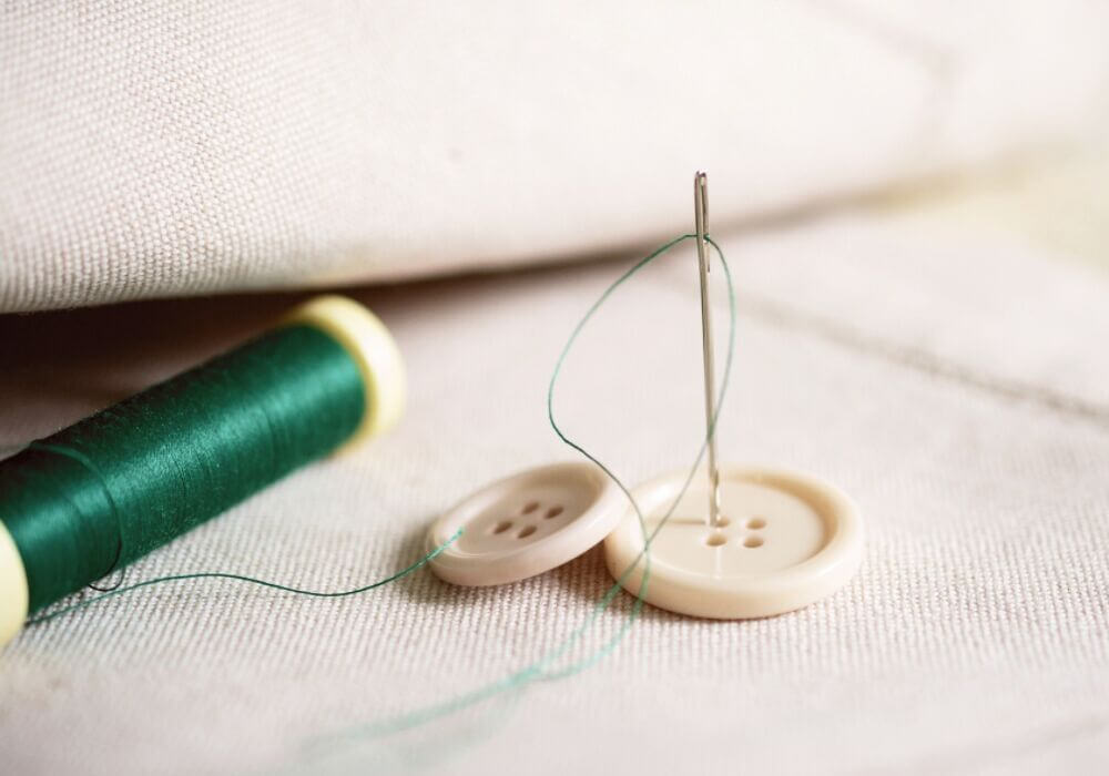 Sewing on a button by hand