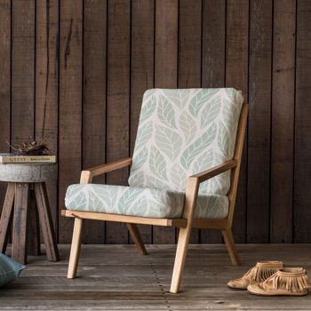 Armchair upholstered with panama printed fabric